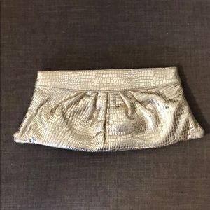 Lauren Merkin gold clutch